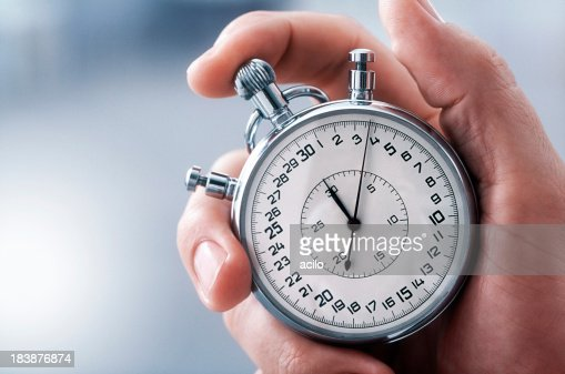 Hand with classic stopwatch