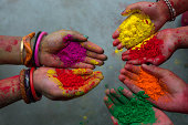Hand with colours at Holi festival,India.