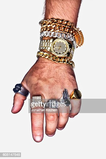 A hand with excess jewellery