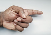 African man's hand pointing left, isolated on a white background.