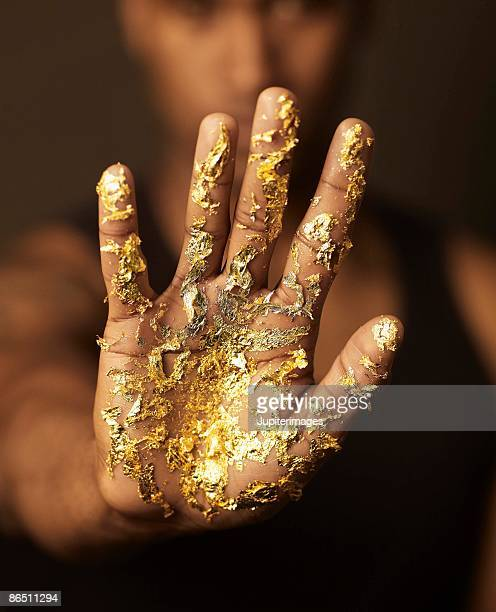 Hand with gold leaf