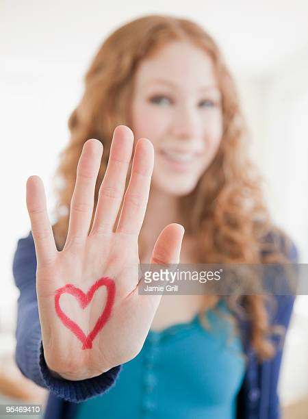 Hand with heart on palm