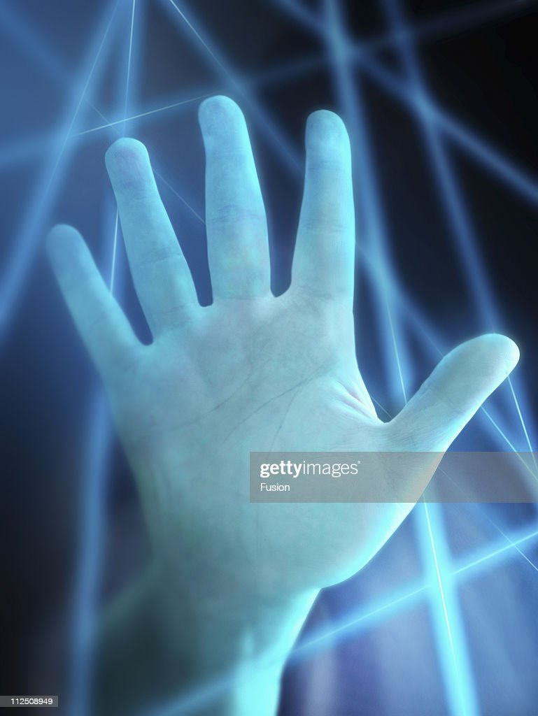 Hand with lasers in background : Stock Photo