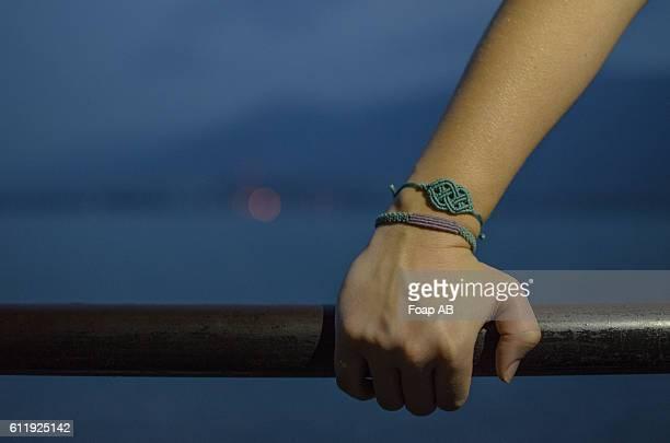 Hand with macrame bracelet