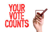 Hand with marker writing the word Your Vote Counts