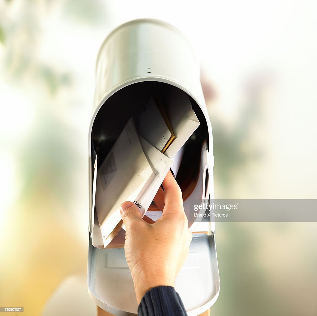 Hand with open mailbox : Stock Photo