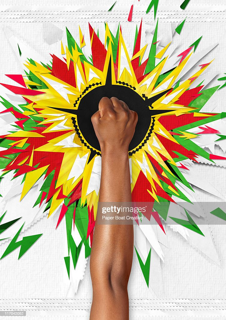 Hand with paper craft of a colorful explosion : Stock Photo