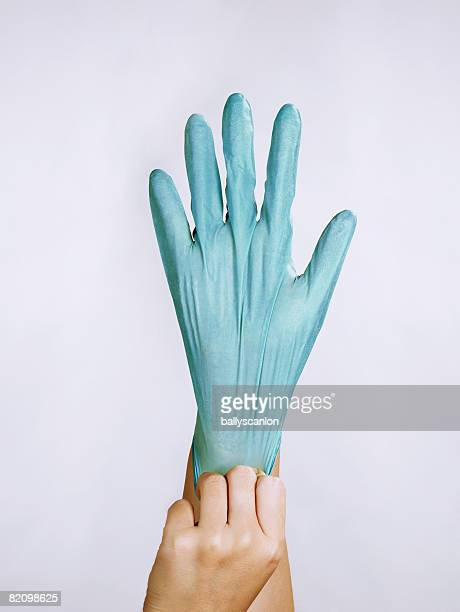 hand with protective rubber glove