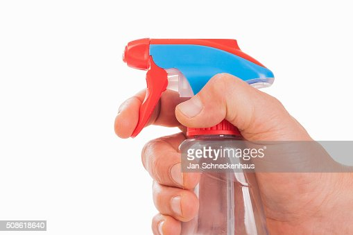 Hand with spray bottle - isolated : Stock Photo