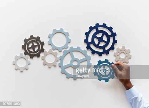 Hand with support gears isolated on white background : Stock Photo