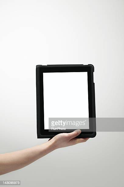 hand with tablet PC,close-up