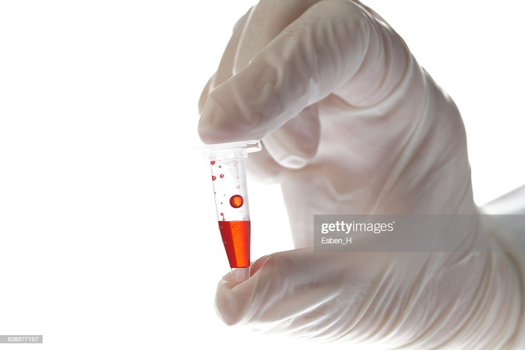 Hand with testtube isolated on white : Stock Photo