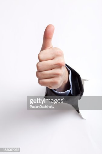 Hand with thumb up against a white background