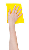 hand with yellow washing rag isolated on white background