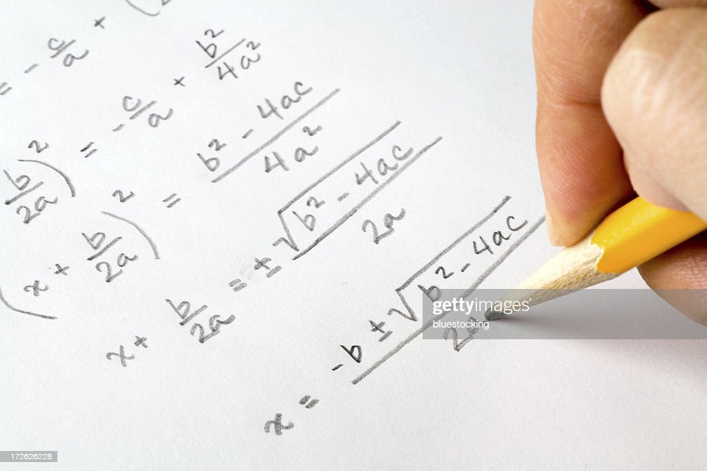 Hand writing algebra equations : Stock Photo