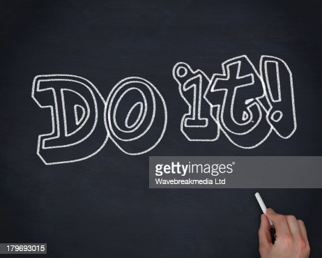 Hand writing do it with a chalk : Stock Photo