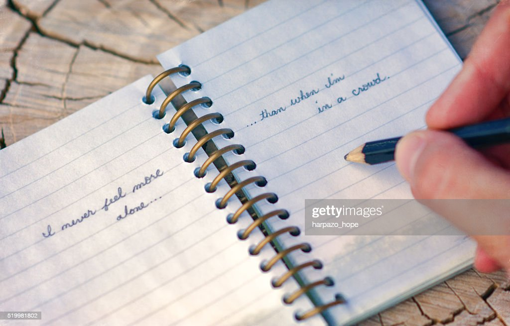 Hand writing in a small notebook.