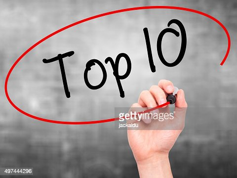 Hand writing Top 10 with marker on visual screen. : Stock Photo