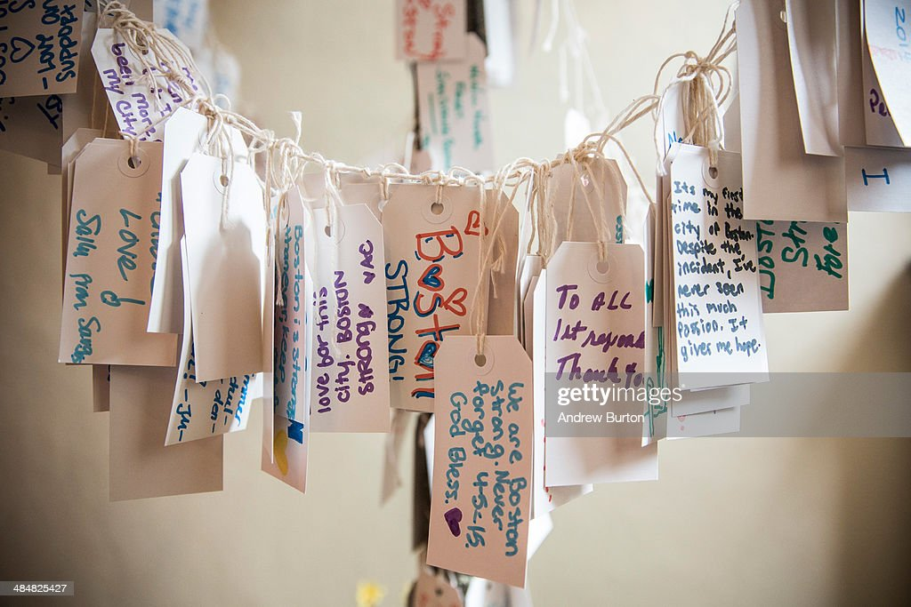 Hand written messages are displayed in an exhibit titled, 'Dear Boston: Messages from the Marathon Memorial' in the Boston Public Library to commemorate the 2013 Boston Maraton bombings, on April 14, 2014 in Boston, Massachusetts. Last year, two pressure cooker bombs killed three and injured an estimated 264 others during the Boston marathon, on April 15, 2013.