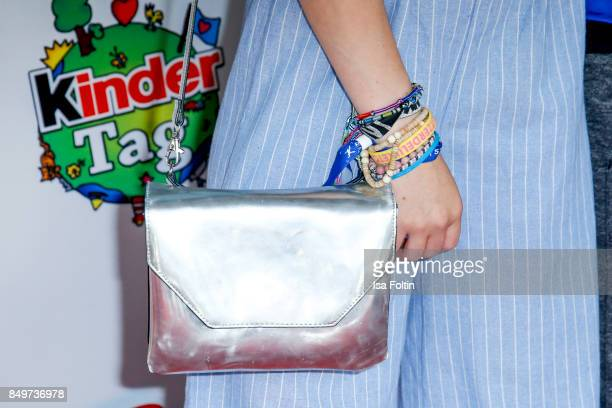 Handbag and bracelets of German actress and singer Lina Larissa Strahl as a detail during the KinderTag to celebrate children's day on September 19...