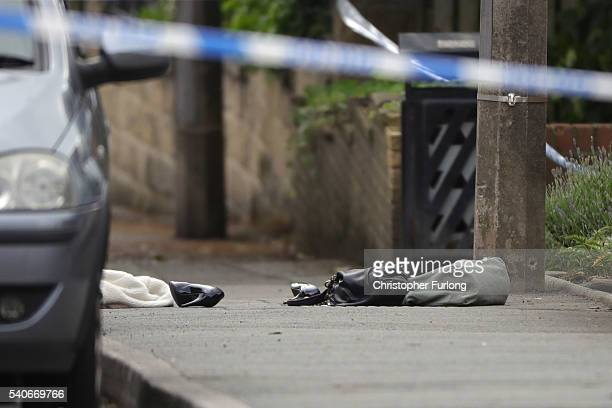 A handbag and shoes lie on the ground as police cordon off an area after Jo Cox Labour MP for Batley and Spen was shot and stabbed by an attacker at...
