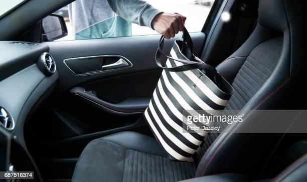 Handbag being stolen from car