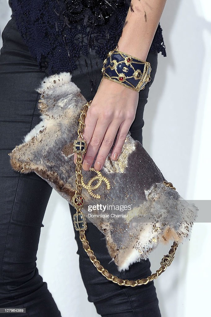 Handbag carried by <a gi-track='captionPersonalityLinkClicked' href=/galleries/search?phrase=Poppy+Delevingne&family=editorial&specificpeople=2348985 ng-click='$event.stopPropagation()'>Poppy Delevingne</a> as she attends the Chanel Ready to Wear Spring / Summer 2012 show during Paris Fashion Week at Grand Palais on October 4, 2011 in Paris, France.