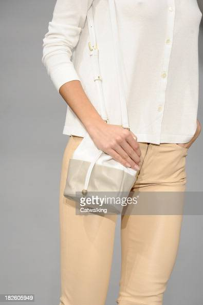 A handbag detail on the runway at the Agnes B Spring Summer 2014 fashion show during Paris Fashion Week on October 1 2013 in Paris France