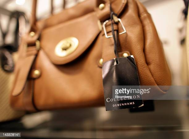 A handbag hangs on display in a Debenhams Plc store at Westfield London shopping mall operated by Westfield Group in London UK on Tuesday April 24...