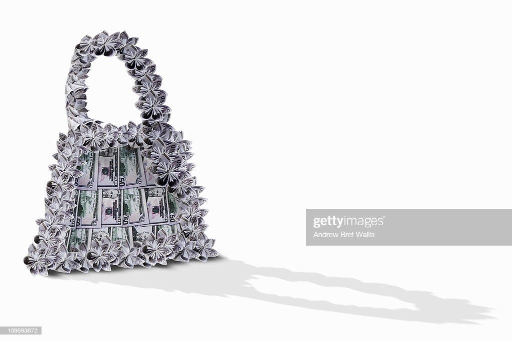 handbag made from 50 dollar notes against white : Stock Photo
