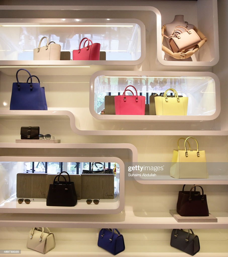 Handbags and sunglasses of Victoria Beckham label are seen at On Pedder at Scotts Square on May 12, 2014 in Singapore. Victoria Beckham is in Singapore for the first time to showcase her ready-to-wear pieces from her eponymous fashion label in Singapore
