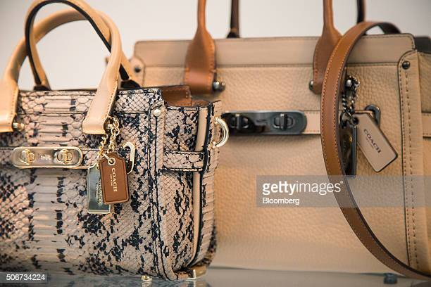 Handbags are displayed in the window of a Coach Inc store in New York US on Thursday Jan 22 2015 Coach Inc is expected to release earnings figures on...