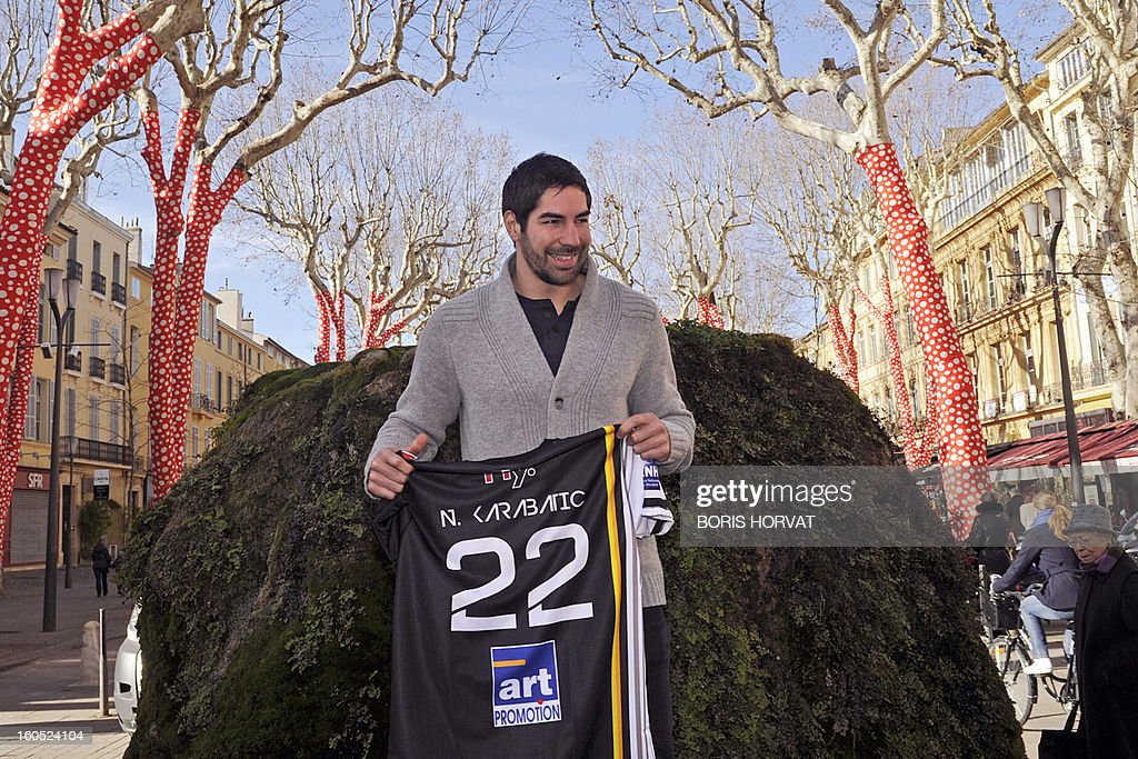 Handball club of Aix-en-Provence (PAUC) newly recruted player Nikola Karabatic poses with his new jersey after he signed a contract with the PAUC on February 2, 2013 in Aix-en-Provence, southern France.