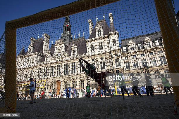 Handball game playing on man-made beach in front of Hotel de Ville during Paris Plage.