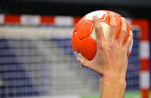 Hand about to throw a handball in to a handball goal