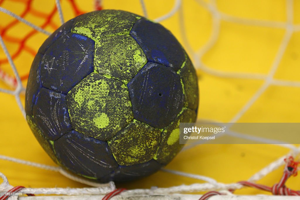 A handball lies in the net during the DKB Handball Bundesliga match between TUSEM Essen and Tus N-Luebbecke at the Sportpark Am Hallo on March 31, 2013 in Essen, Germany.
