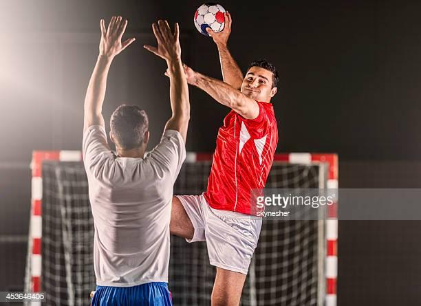 Handball player in action.