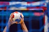 Handball Player holding a handball