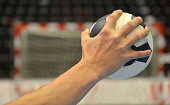 Handball Player about to shoot a handball into the goal.