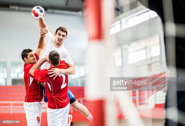 Handball player shooting at goal.