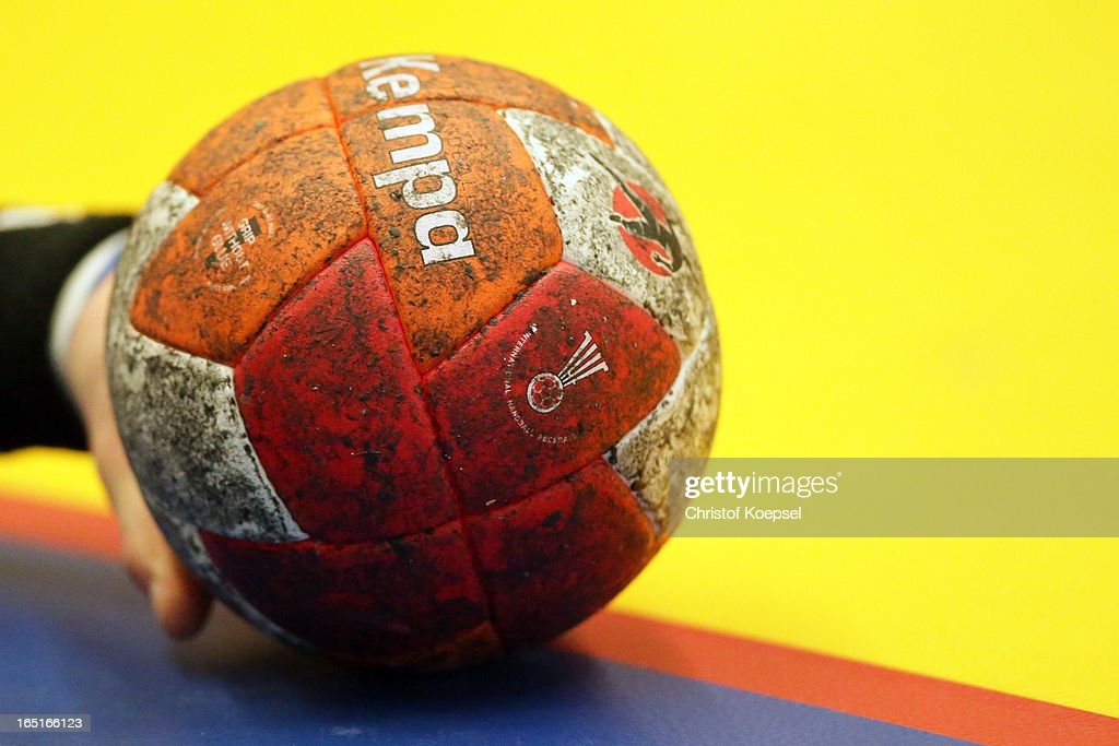 A handballer holds the handball during the DKB Handball Bundesliga match between TUSEM Essen and Tus N-Luebbecke at the Sportpark Am Hallo on March 31, 2013 in Essen, Germany.