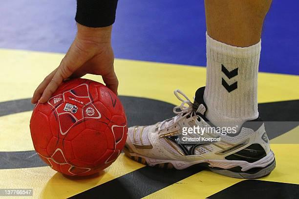 A handballer picks up a ball during the Men's European Handball Championship second round group one match between Serbia and Macedonia at Beogradska...