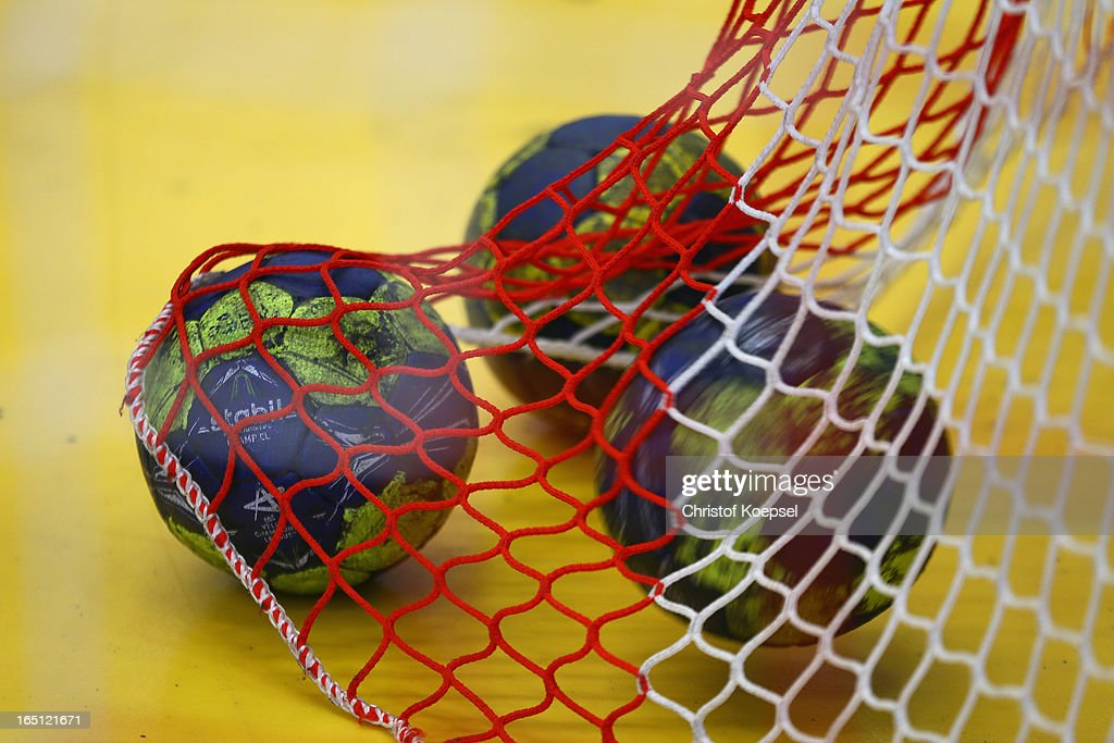 Handballs lie in the net during the DKB Handball Bundesliga match between TUSEM Essen and Tus N-Luebbecke at the Sportpark Am Hallo on March 31, 2013 in Essen, Germany.