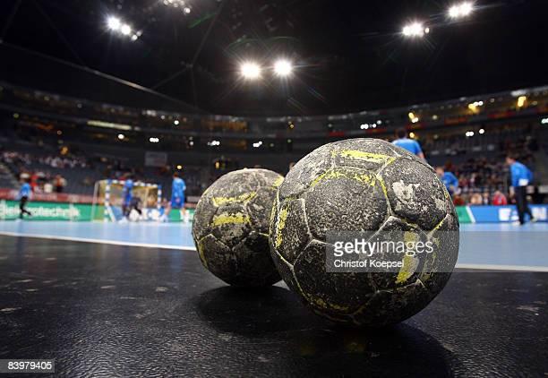 Handballs lies on the ground before the Handball Bundesliga match between VfL Gummersbach and HSV Hamburg THW Kiel at the Lanxess Arena on December 9...