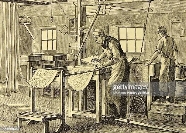 Handblock printing rolls of calico Lancashire England The assistant is keeping the pan of colour ready for block to be recharged Engraving London 1880