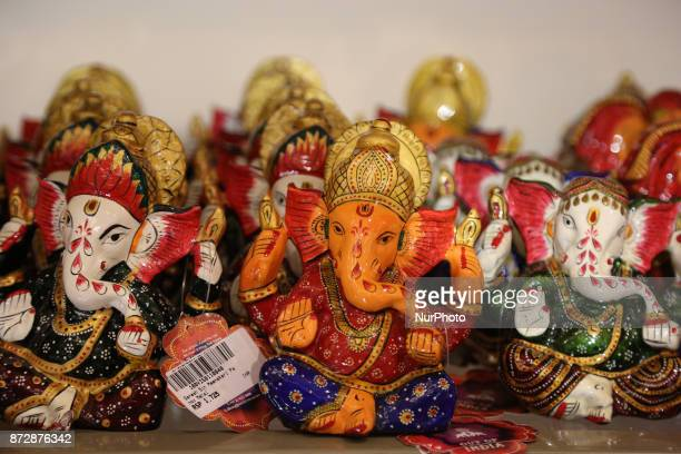 Handcarved wooden figures of Lord Ganesh at a shop in Mumbai India