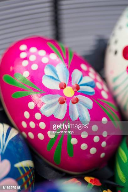 Handcolored easter eggs in a basket