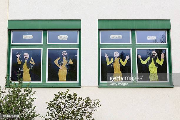 Handcrafted images of Conchita Wurst are seen in the windows of the Volksschule on May 14 2014 in Bad Mitterndorf Austria Bad Mitterndorf is the...