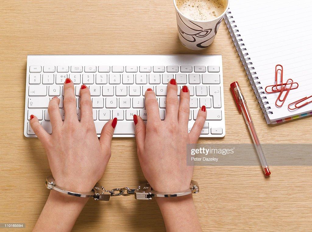Handcuffed businesswoman : Stock Photo