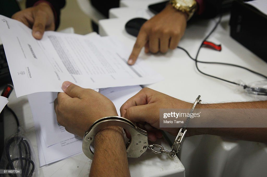 A handcuffed inmate meets with an attorney to update his case in the overcrowded Puraquequara prison on February 18 2016 in Manaus Brazil The prison...